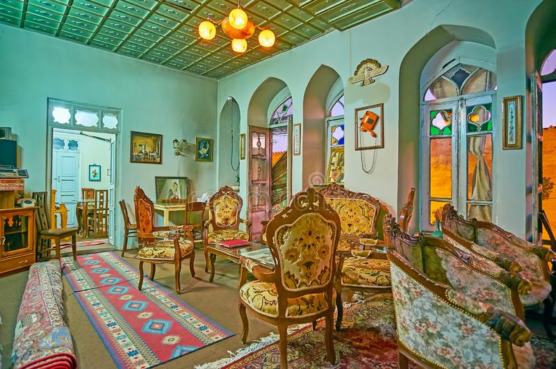 SHIRAZ, IRAN - OCTOBER 14, 2017: Family restaurant in historic mansion: the room is decorated in classic style with vintage carved royalty free stock photography