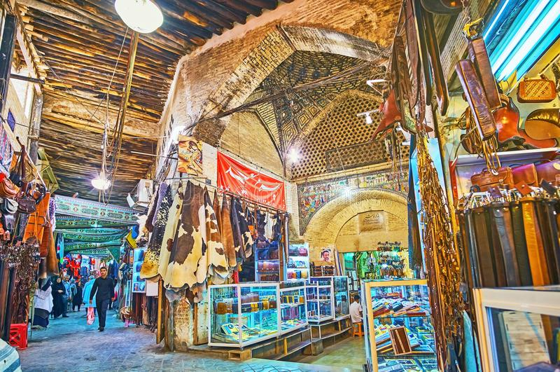 Chaotic alleys of Eastern bazaar, Shiraz, Iran. SHIRAZ, IRAN - OCTOBER 12, 2017: The maze of covered alleys of old market - the fork of Mesgarha Bazaar and royalty free stock images