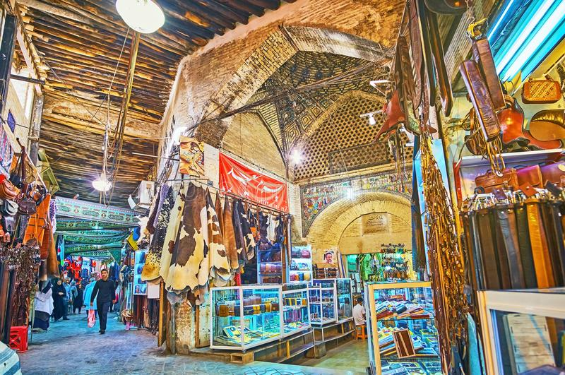 Chaotic alleys of Eastern bazaar, Shiraz, Iran. SHIRAZ, IRAN - OCTOBER 12, 2017: The maze of covered alleys of old market - the fork of Mesgarha Bazaar and royalty free stock photos