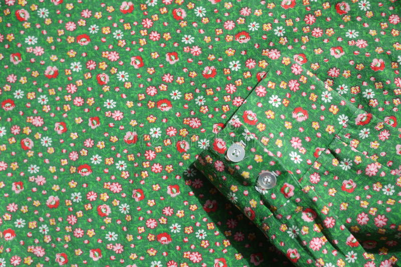 Shirt Cuff Vintage real fabric 1960s cotton emerald green with red roses and yellow flower pattern stock photography
