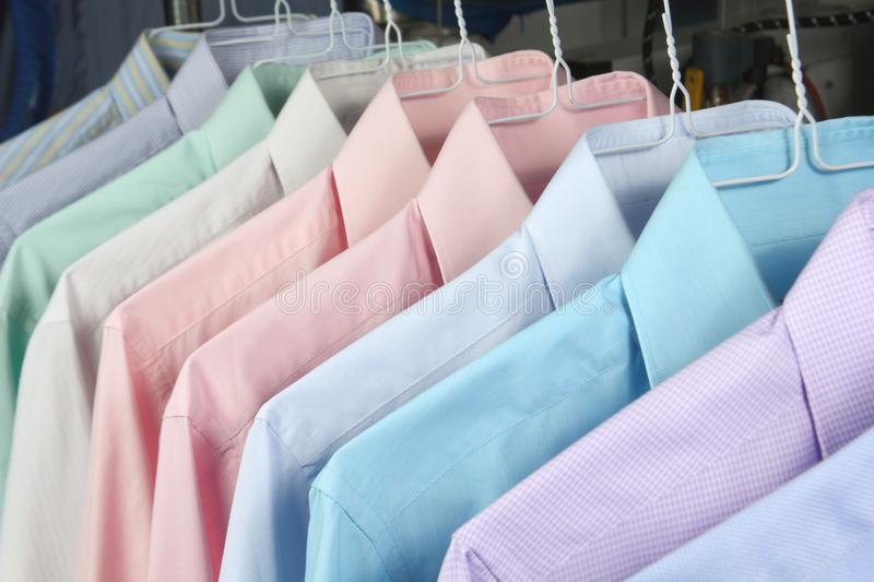 Shirt ironed in dry cleaner. Hanging on hangers stock images