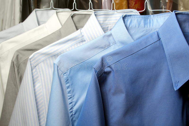 Shirt ironed in dry cleaner. Hanging on hangers royalty free stock images