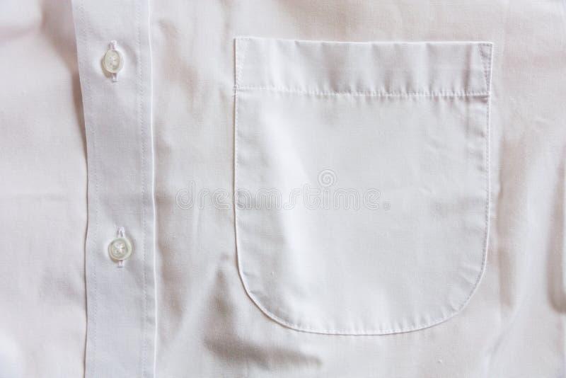 Shirt pocket. Detail white shirt, buttons and pocket shirt stock photography