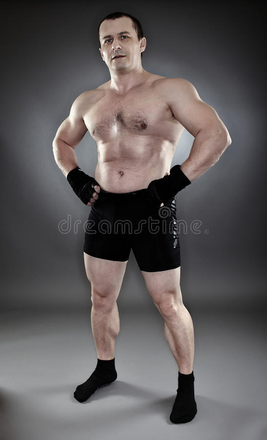 Shirtless Athletic Muscular Man Standing Akimbo Stock Photo