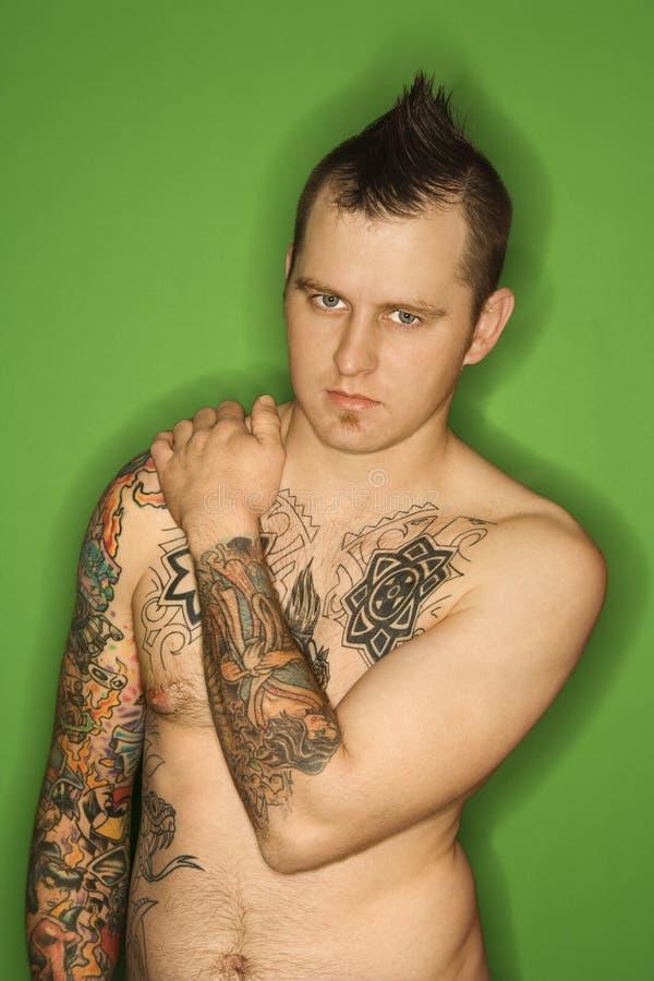 Shirtless Caucasian man with tattoos. stock photography