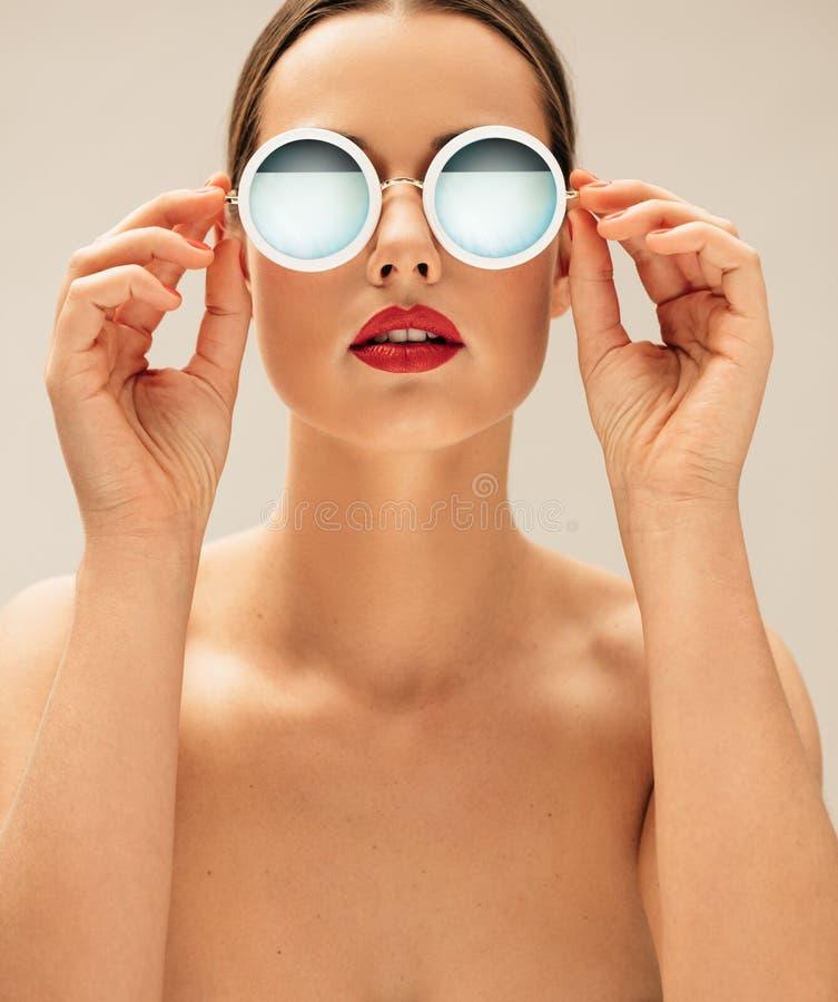 Shirtless female model wearing sunglasses royalty free stock photos