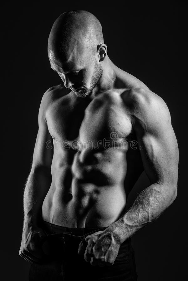Shirtless and fit male stock images