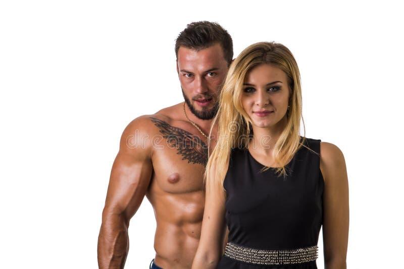 Shirtless, geschikte spierman en mooie blondevrouw stock foto