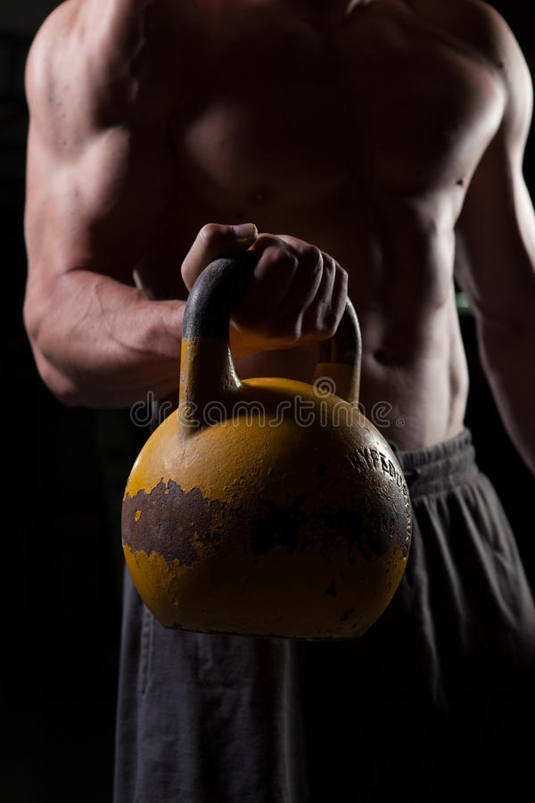 Download Shirtless Guy Holding A Dumbbell Stock Image - Image: 14676765