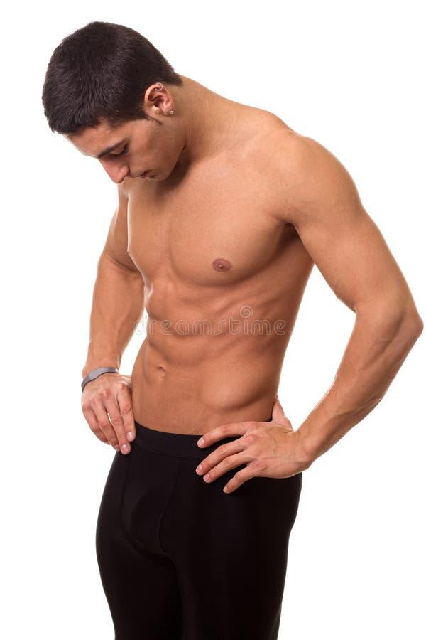 Shirtless idrotts- man arkivfoto