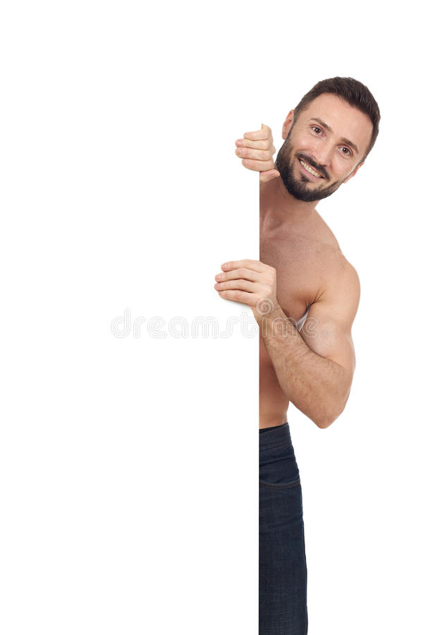 Shirtless man with blank sign royalty free stock photo