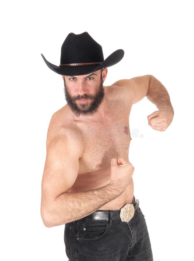 Shirtless man with a cowboy hat showing his muscles stock photo