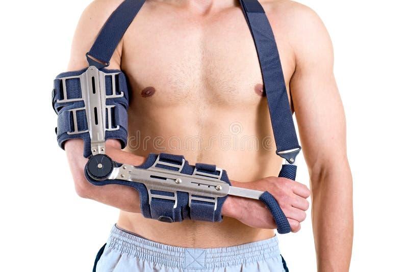 Shirtless man med armen i artikulerad rem royaltyfria foton