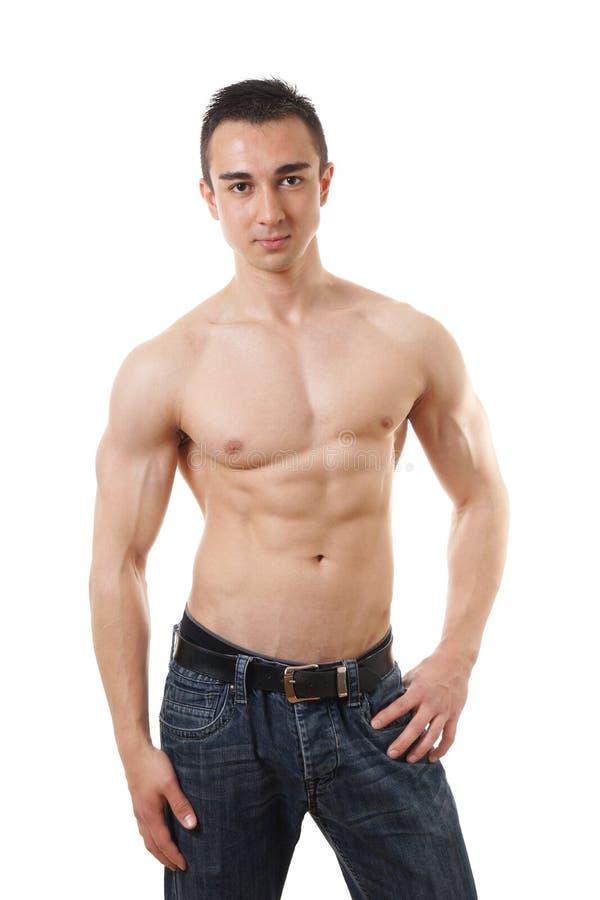 Shirtless man med den tonade kroppen arkivbild