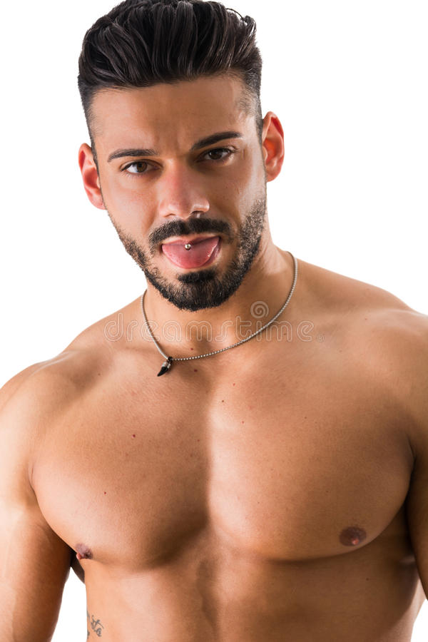 Shirtless man with piercing. Young handsome shirtless muscular man with tongue out showing the piercing isolated on white stock photos