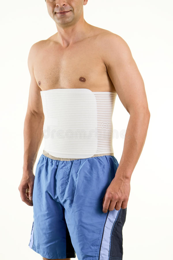 Shirtless Man Wearing Brace to Support Core royalty free stock photos