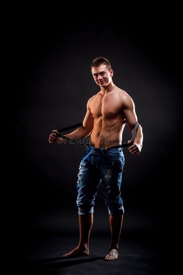 Shirtless mens in bretels stock foto