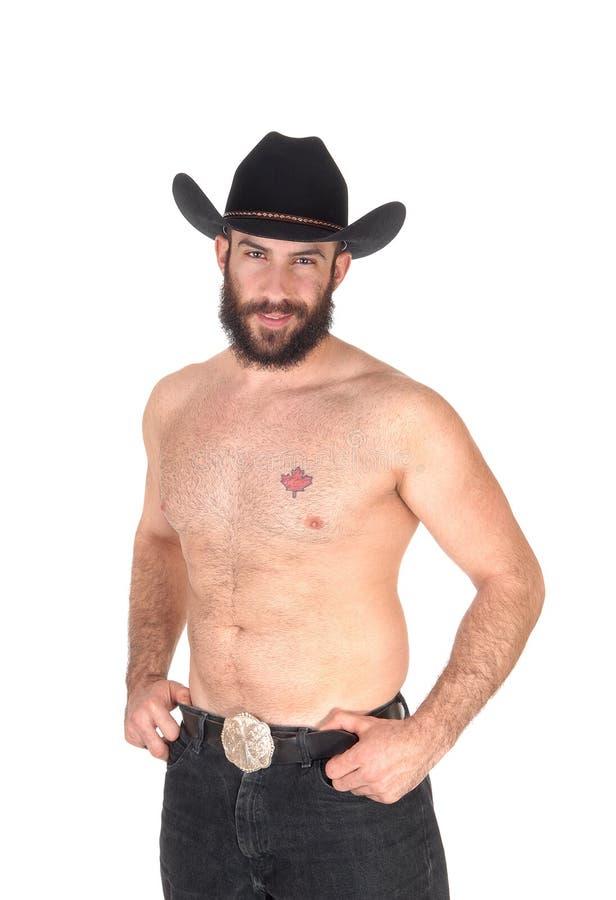 Shirtless mens met een cowboyhoed, die de camera bekijken royalty-vrije stock afbeeldingen