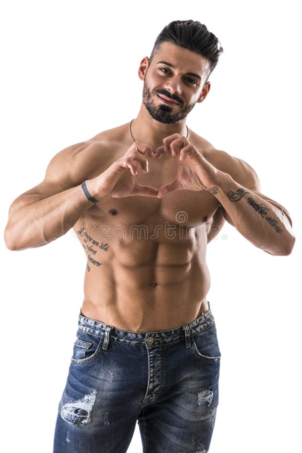 Shirtless muscular man making heart sing with hands royalty free stock images