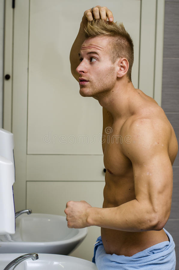 Shirtless, Muscular Young Man Looking At His Hair In Bathroom Mi ...