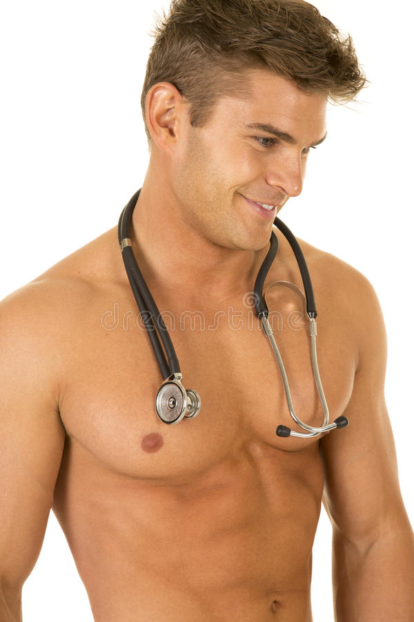Shirtless strong man stethoscope close look side smile. A Doctor with a muscular body with his stethoscope around his neck, and a smile royalty free stock photography