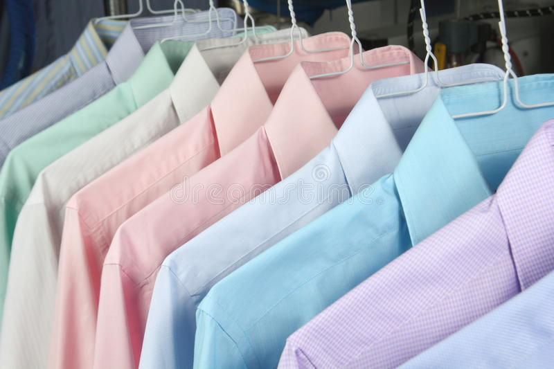 Shirts at the dry cleaners freshly ironed. Las camisas estan en perchas royalty free stock photos