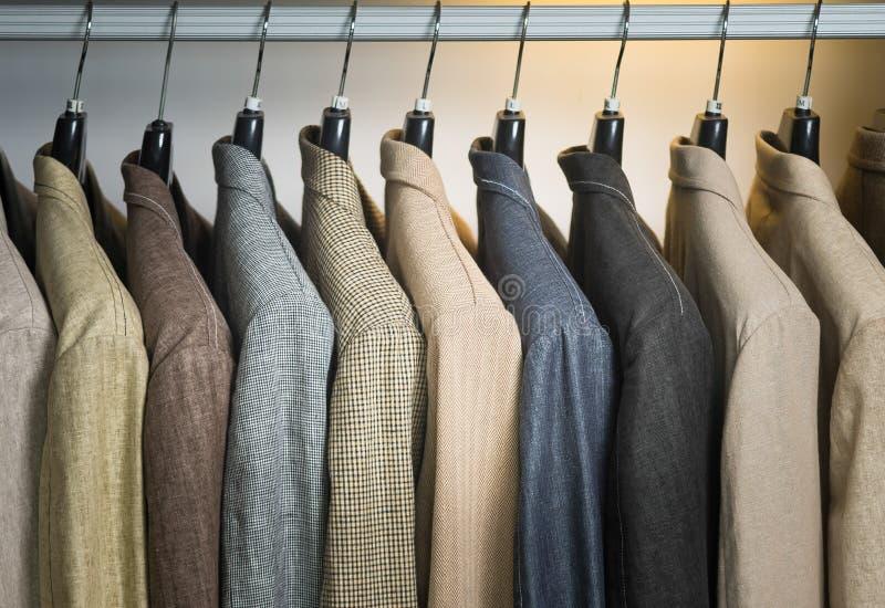 Shirts. man shirts on hangers royalty free stock photography