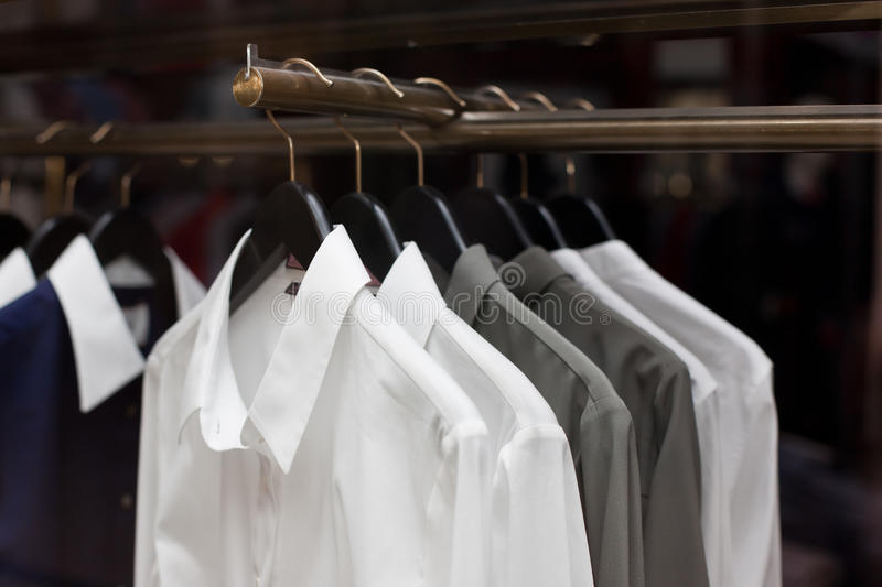 SHIRTS FOR SALE IN A STORE royalty free stock photos