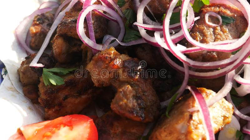 The shish kebab is fried on a brazier. Preparation of a shish kebab. Grill, skewers. stock photos