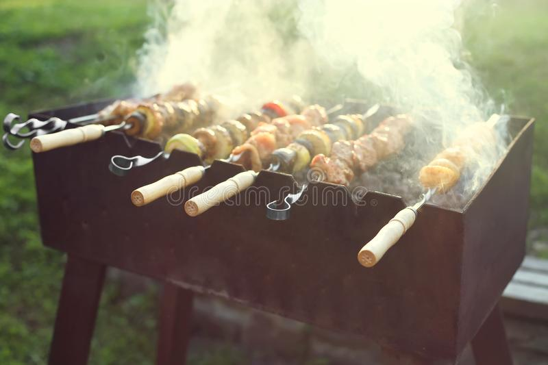 Atmosphere cooking meat and vegetables on the grill royalty free stock photography