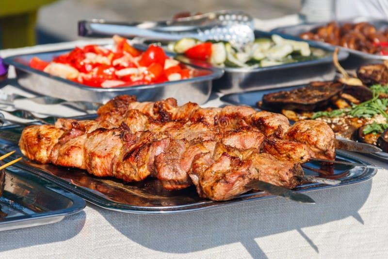 Shish kebab and other street food on table stock photos