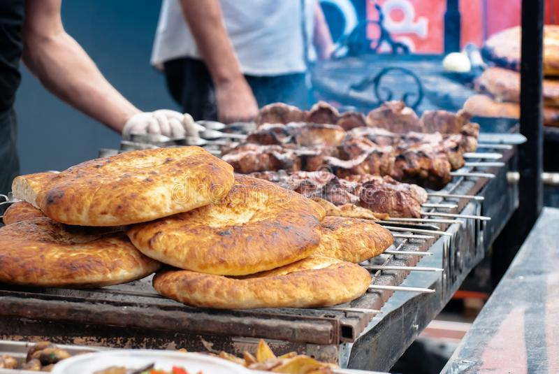 Shish kebab and pita bread on grill, close-up stock images