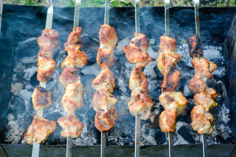 Shish kebab on skewers stock images