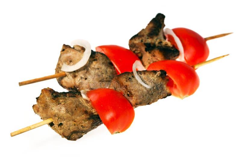 Shish kebab with tomato royalty free stock photo