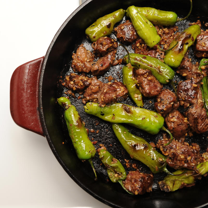 Shisito Peppers. And filet mignon royalty free stock image