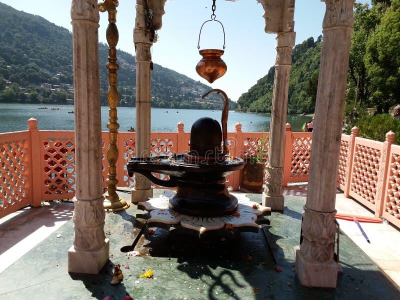 Shiv ling at naiana devi, nainital. Shiv ling with pot at naiana devi in nainital , in the background naini lake and mountains stock photos