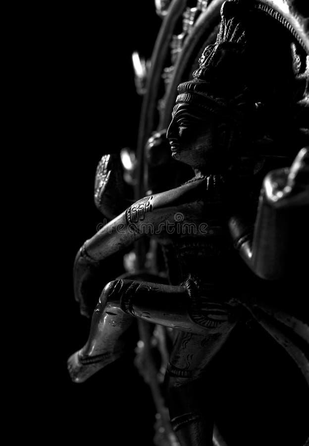 Shiva, ein hinduistischer Gott, auf schwarzem Hintergrund stockbilder