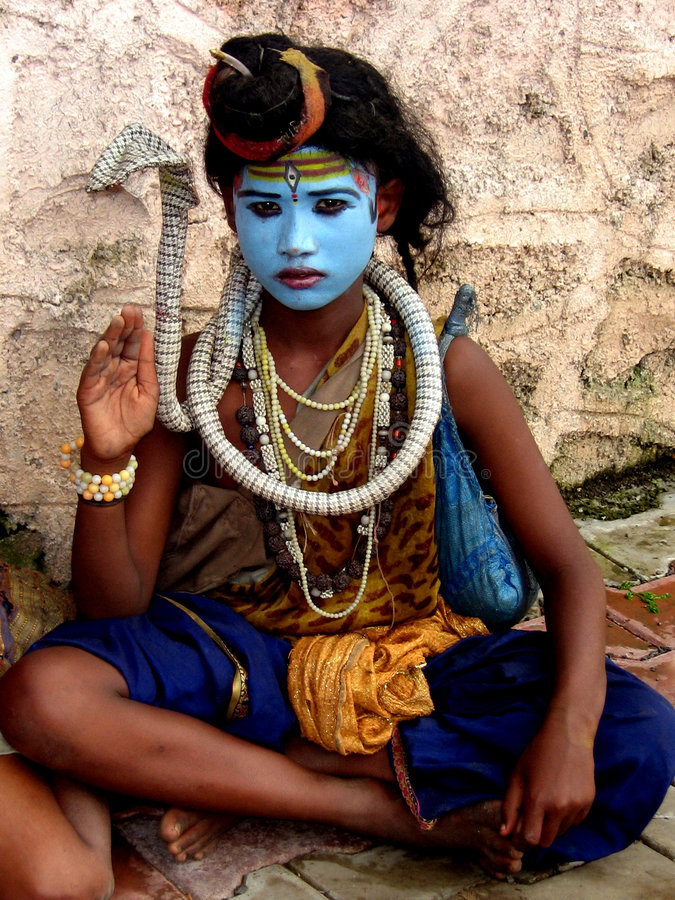 Shiva Impersonation. A little boy from India impersonates lord Shiva - The destroyer, The God who considered to handle destruction on the planet royalty free stock photography