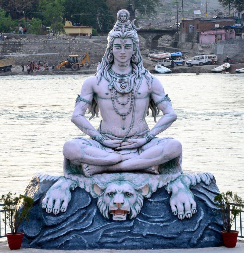 Shiva. A large idol of the hindu God Shiva on the banks of River ganga stock image