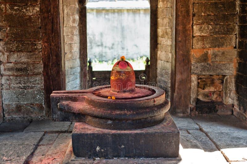 Shiva lingam of Pashupatinath temple. And cremation ghats, Khatmandu, Nepal stock photography