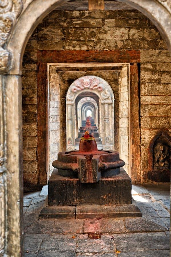 Shiva lingam of Pashupatinath temple. And cremation ghats, Khatmandu, Nepal royalty free stock photo