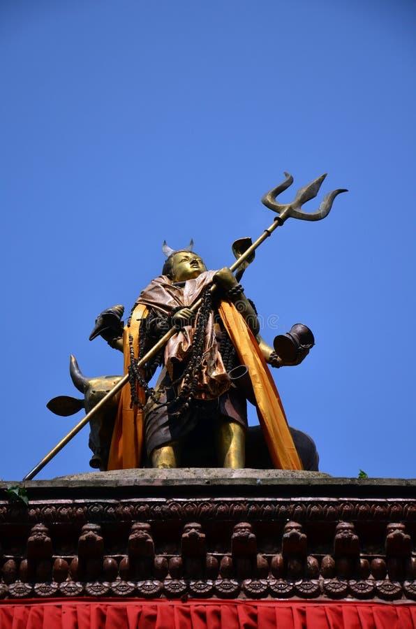 Shiva on roof of Hanuman Dhoka in Basantapur Durbar Square royalty free stock photos