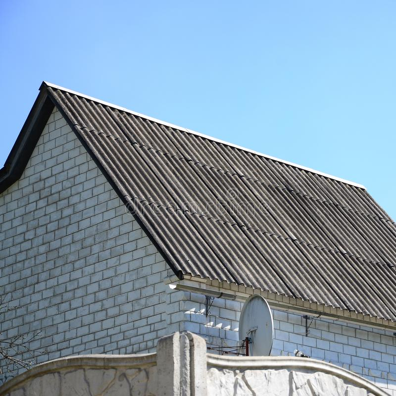 Shiver white roofs bring cool savings in residental attic. White Roofs Bring Cool Savings. For homes in warm climates, cool roofs can reduce air conditioning stock photography