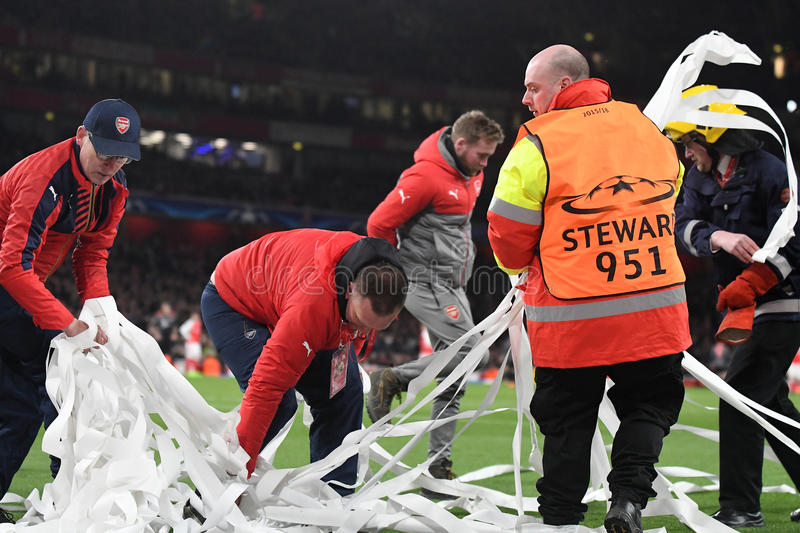Workers cleaning confetti off the pitch. During UEFA Champions League Group Last 16 Round game between Arsenal FC and Bayern Munich on March 7, 2017 at Emirates royalty free stock photos