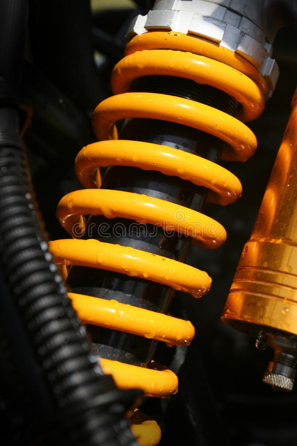 Shock absorber. Yellow shock absorber of a quad bike royalty free stock photos