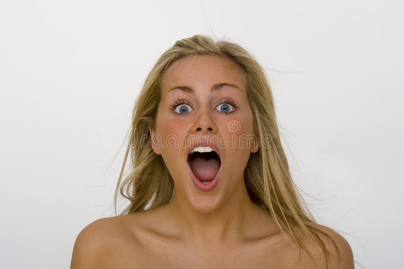 Shock and Awe. A beautiful blond haired blue eyed woman in open mouth shock stock images