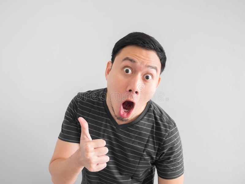 Shocked and surprised face of Asian man point on empty space. stock photos