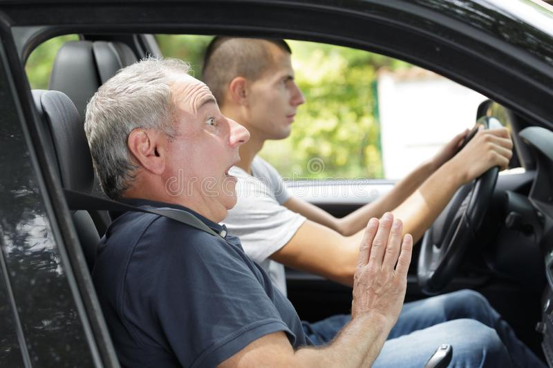 Shocke teacher with student learning to drive royalty free stock image