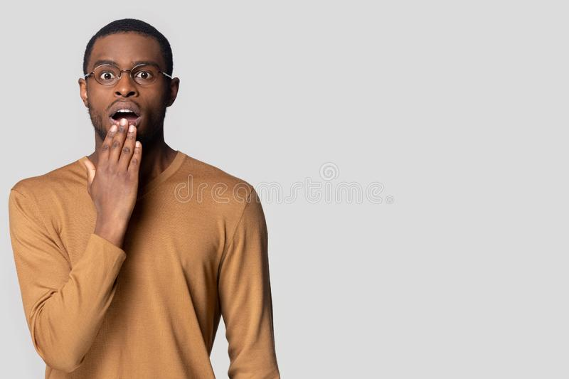 Shocked black man in glasses amazed by sale offer royalty free stock photography