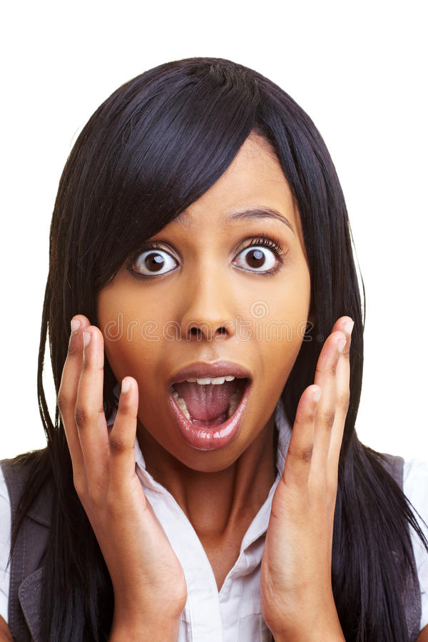 Shocked african woman. Young african woman looking shocked into the camera stock images
